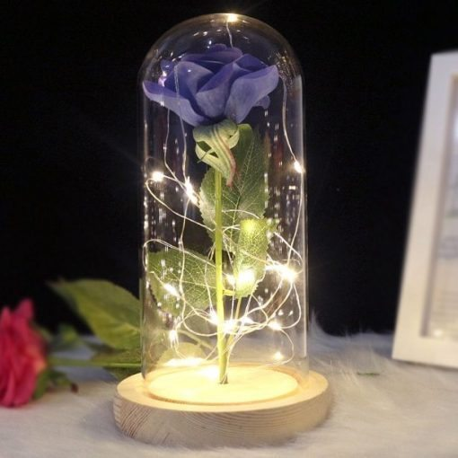 rose éternelle bleue lumineuse sous cloche