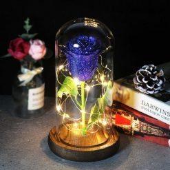 rose éternelle lumineuse sous cloche bleue à paillettes