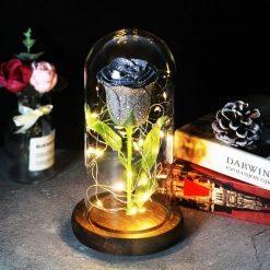 rose éternelle lumineuse sous cloche grise à paillettes
