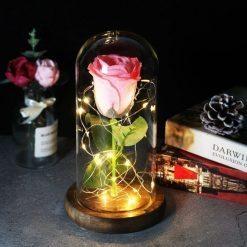 rose éternelle lumineuse sous cloche rose à paillettes